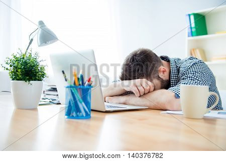 Close Up Of Tired Man Having Long Working Day And Sleeping On Table