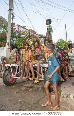 Pondicherry, Tamil Nadu, India - May 15, 2014 : each year in villages, people celebrate the temple fest, for the full day. They walk in groups, they launch paint on people, play music.