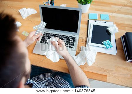 Close Up Of Workplace Of Sick Worker Holding Pills And Napkin