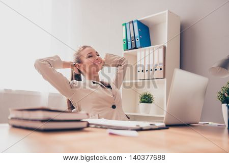 Happy Relaxed Woman Having Break And Resting In Office