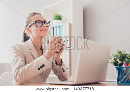 Minded Woman In Glasses Dreaming With Cup Of Coffee During Her Break