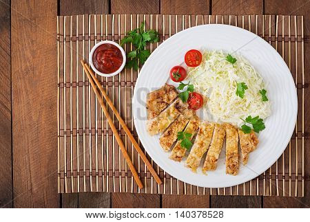 Fried Pork Cutlet With Fresh Cabbage Salad And Sauce. Top View