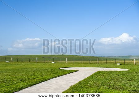 Helicopter landing platform on beautiful green field and blue sky summer landscape in Victoria Australia