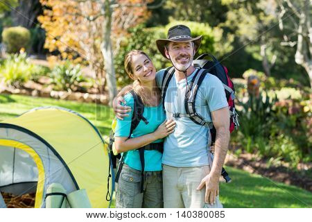 Hiker couple embracing each other in forest