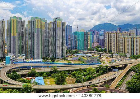 hong kong public estate with landmark lion rock at day