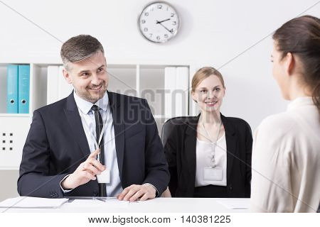 Businessman Gesturing At Woman