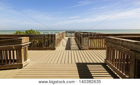 Wooden path to the beach in sunny day, Florida