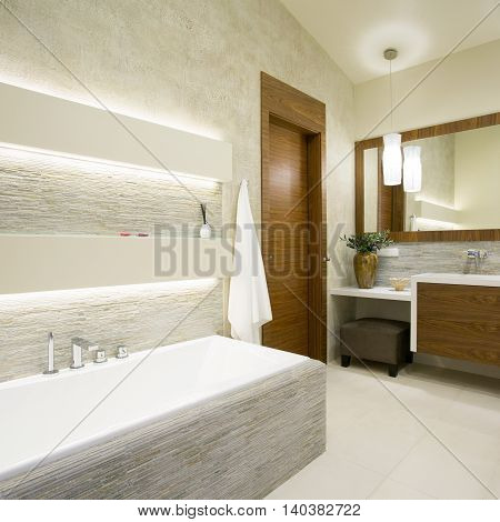 Bath and washbasin in modern bathroom interior