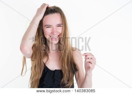 Beautiful Blond Woman With Long Hair Touching Her Hair
