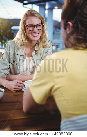 Happy couple having coffee in cafeteria