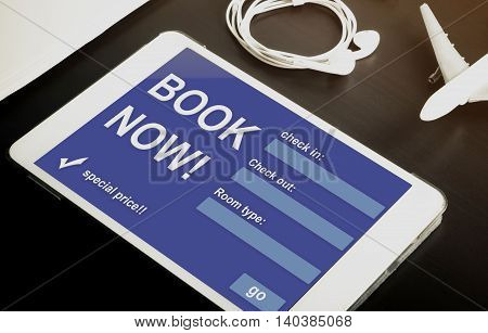 Book your hotel online using your Tablet or mobile devices now. Travel agency website on tablet. Online accommodation booking website on tablet screen.