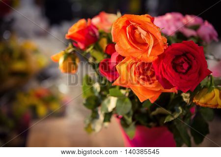 Close-up of orange and red roses at flower shop