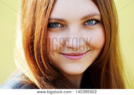 Portrait of a happy woman smiling outdoors. close-up