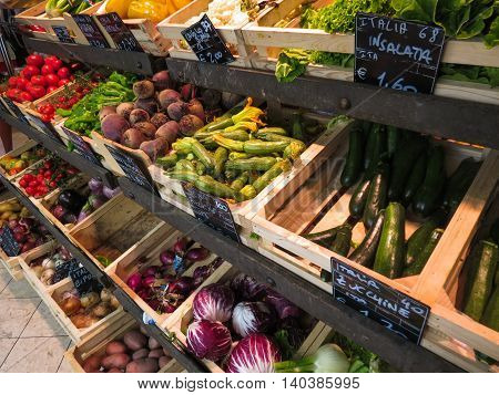 SIENA ITALY - CIRCA JULY 2016: Fruits and vegetables on display at small grocery store produce market greengrocer