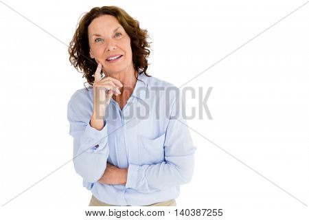 Smiling thoughtful woman against white background