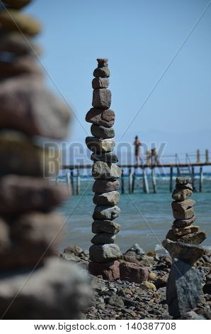 High column of stones on the shore of the Gulf of Aqaba