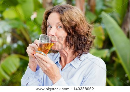 Close-up portrait of mature woman drinking herbal tea