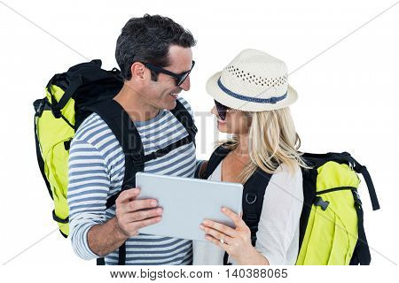 Cheerful couple holding digital tablet against white background