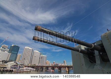 SYDNEY, AUSTRALIA - APRIL, 2016 : Closeup of Australian Daring-class destroyer HMAS Vampire ship docking at Darling Harbour with Pyrmont Bridge in background, Sydney, Australia on April 21, 2016.