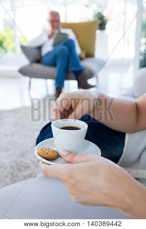 Cropped image of woman having breakfast at home