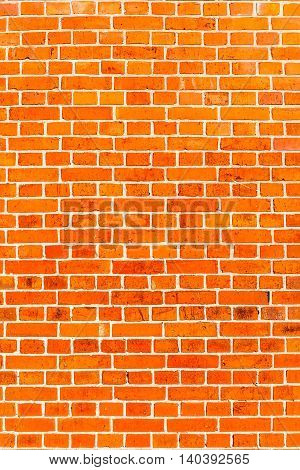 Pattern of red brick wall texture use as background.