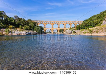Provence, spring sunny day. Three-tiered aqueduct Pont du Gard - the highest in Europe. The bridge was built in Roman times on  river Gardon