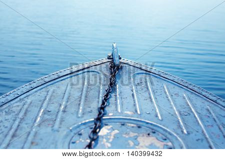 fore part of boat. head boat sailing on blue sea with anchor chain