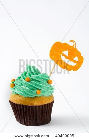 Sweet halloween cupcake isolated on white background