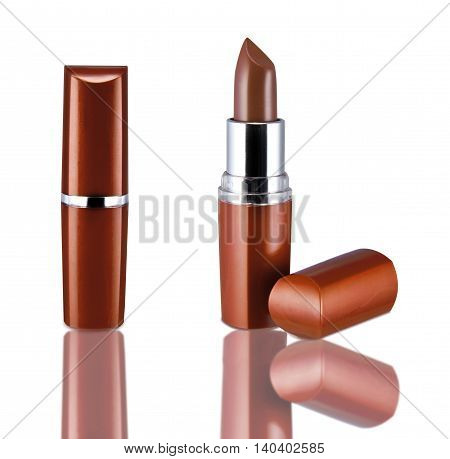 Brown lipstick in a mirror on white background