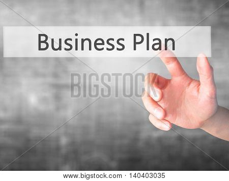Business Plan - Hand Pressing A Button On Blurred Background Concept On Visual Screen.