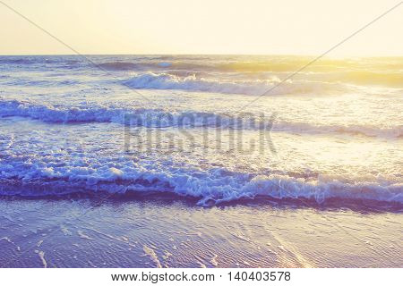 An abstract ocean seascape waves background evening sunset sunrise vintage filter