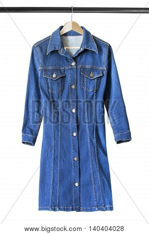 Blue denim dress on wooden clothes rack isolated over white