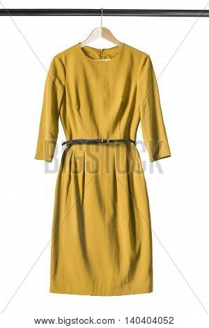 Yellow dress on wooden clothes rack isolated over white