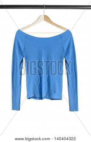 Blue cotton top on wooden clothes rack isolated over white