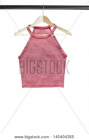 Pink crop top on wooden clothes rack isolated over white
