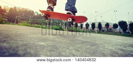 one young skateboarder legs skateboarding at skatepark