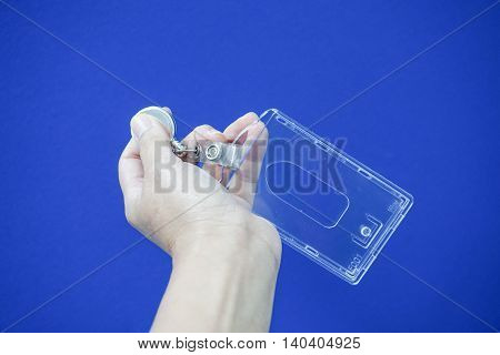 Blank plastic business nametag in woman hand