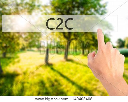 C2C - Hand Pressing A Button On Blurred Background Concept On Visual Screen.