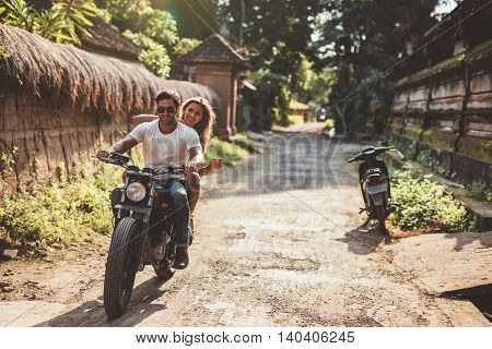 Young Couple On Motorcycle Ride