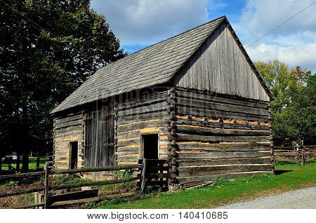 Lancaster Pennsylvania - October 14 2015: Circa 1750 Germanic fachwerk Log Farm home at the Landis Valley Village and Farm Museum