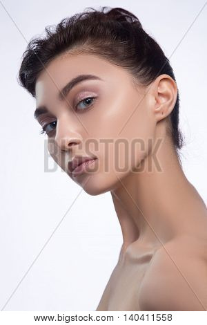 Beauty Girl. Beautiful Young Woman with Fresh Clean Skin. Pure Natural Beauty. Isolated on a White Background.