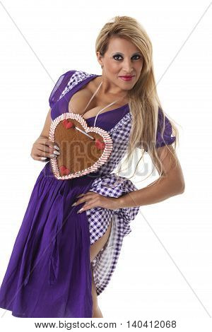 blonde woman in a bavarian dirndl on white
