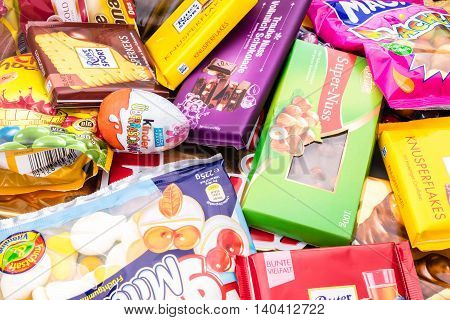 Germany - June 21, 2016: different sweets. Candy heap. chocolate, candys surprise eggs Empty calories