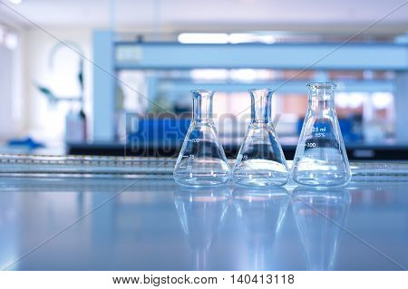 flask and pipet glassware in science lab