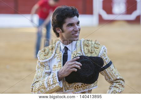Sabiote SPAIN September 9 2011: The Spanish Bullfighter Cayetano Rivera to the turning of honour with an ear in his hand in the Bullring of Sabiote Spain