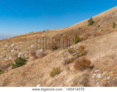 Autumnal landscape with hiking path on a mountain pasture Demerdzhi Crimean peninsula