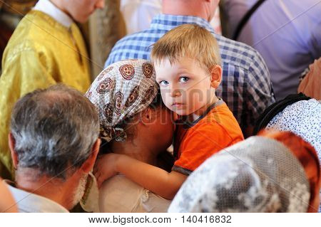 Orel Russia - July 28 2016: Russia baptism anniversary Divine Lutirgy. Little boy stairing in crowd of people