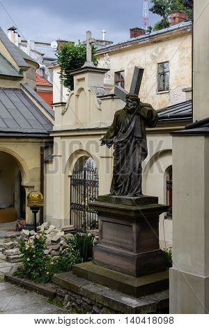 Ancient statue of Christ carrying the Cross, in the yard of the Armenian Church in Lviv.