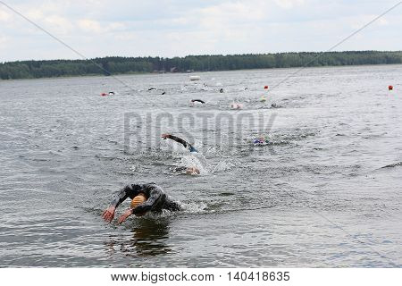 Swimming Athletes In A Triathlon Contest