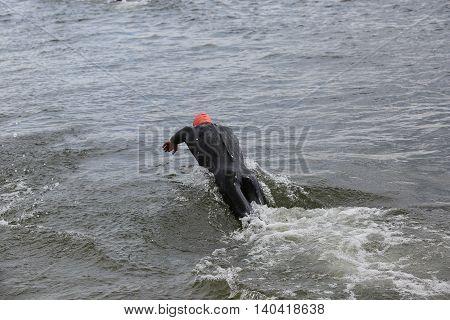 Diving Athlete In Triathlon Competition